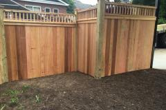 #24 Cedar Solid Board Fence with 2x2 Topper Stepped
