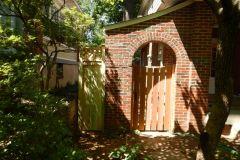 #22 Cedar Spaced Gate on Brick Wall